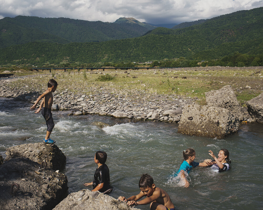 Kids splash and cool off in the Alazani River in Pankisi Valley, Georgia.