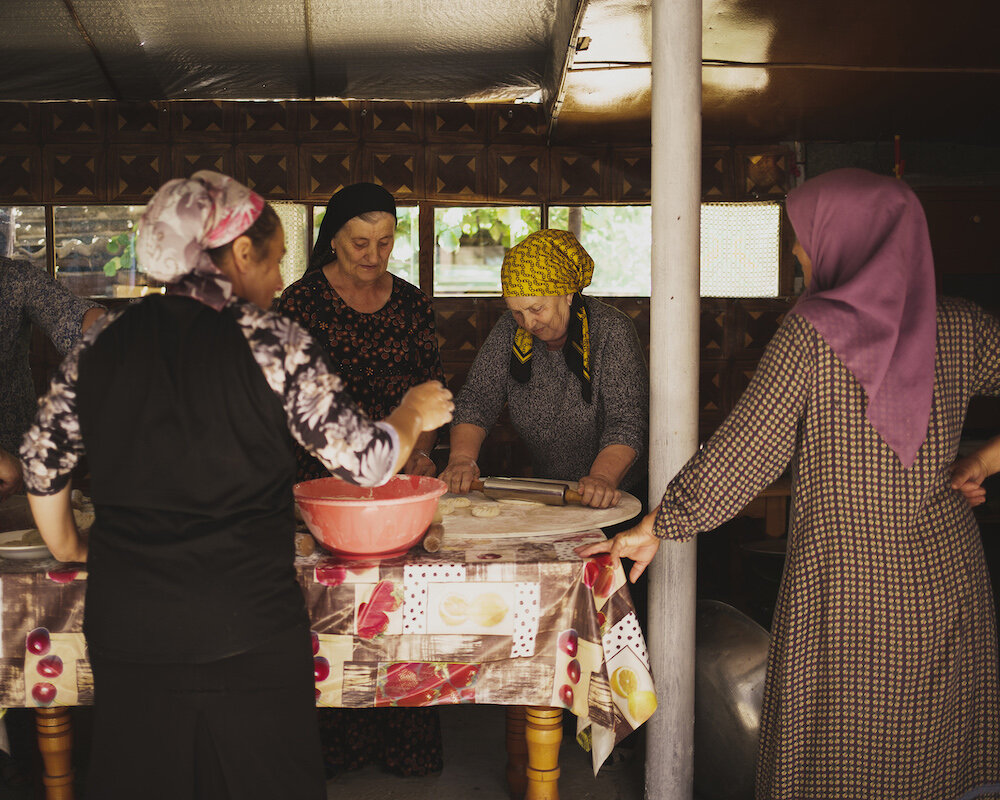 Women prepare food for the Supra, a traditional Georgian feast, that they will serve and enjoy after the zikr ceremony.